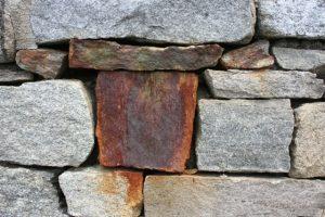 Odd stone in a wall